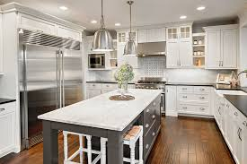 beautiful contrasting kitchen island with gray cabinet and marble countertops