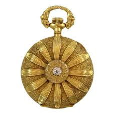 gruen 14k yellow gold pendant watch with textured flower with diamond center for