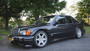 Building upon the evo i from the previous year, the evo ii received drastic aerodynamics upgrades—widened fenders, aggressive side skirts, a large adjustable rear wing, and a rear window spoiler. 1990 Mercedes Benz 190e Cosworth Evo Ii On Ebay With 29 000 Miles