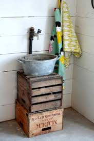 an old flower pot can also make for an adorably simple outdoor sink