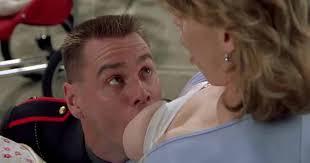Man feeding woman breast