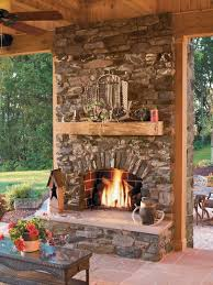 inspiration for a rustic backyard stone patio remodel in san go with a fire pit and