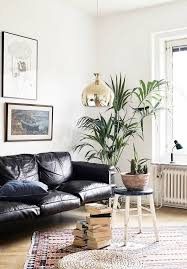 living room with a black leather sofa