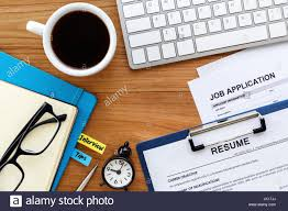 Job Search With Resume And Job Application On Computer Work Table