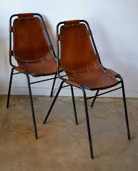 black metal frame and saddle leather side chairs designed by charlotte perriand