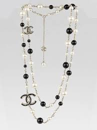 chanel necklace. chanel white/black beaded and cc logo long necklace n