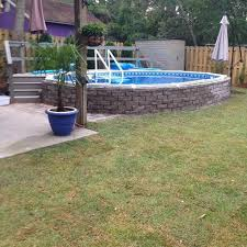 aquasport semi inground pool above finished with rough grade 64e39a81583047a398531bd4ca8b1227 partial inground pool i54