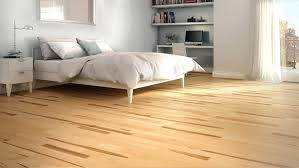 rug under bed hardwood floor. Carpet Vs Laminate In Bedroom Medium Size Of Hardwood Cost Comparison Rug Under Bed Floor I