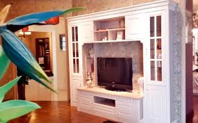 white wooden tv stand with showcase glass door corner tv stands images