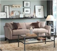 wall decor behind couch design mistakes art hung the right height credenza living room