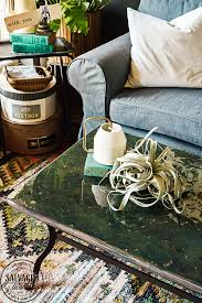 heat or lighter turn a thrifted coffee table into a boho chic piece of furniture with rich moody colors