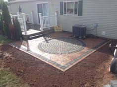 stone patio installation: golden brown nicolock paver patio installation in stone ridge xl with granite city blend sante