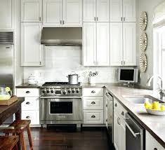 cup pulls for kitchen cabinets concrete cup pulls white cabinets dark woods how to install cup