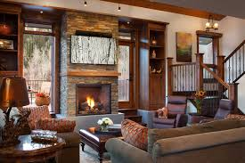 living room with stone fireplace with tv. Mountain Style Living Room Photo In Denver With A Standard Fireplace And Stone Tv