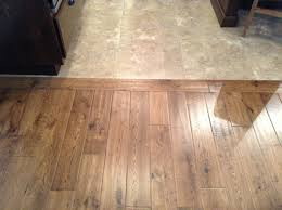 stylish ideas flooring transitions from wood to tile choosing a kitchen floor transition from tile to