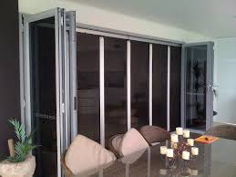 Folding patio doors with screens Outdoor Folding Patio Doors Insect Screen Monarch Maxi Retractable Insect Screen Doors For Large Openings 1600 Home Improvement Ideas Folding Patio Doors Insect Screen Exterior Doors And Screen Doors