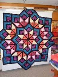 Pattern is by Derek Lockwood called Starburst. I made this quilt ... & Pattern is by Derek Lockwood called Starburst. I made this quilt for my  oldest granddaughter. It is machine pieced and hand quilted. Adamdwight.com