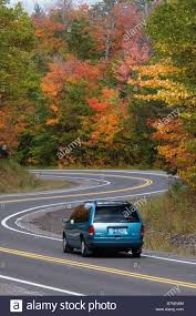 car driving down road. Brilliant Down Car Driving Down Winding Road Through Autumn Forest In The Keweenaw  Penninsula Upper Michigan  To