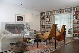 living room oriental rug classic modern t chair designer william katavolos book