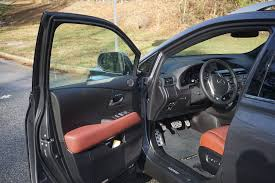 lexus rx 350 interior 2015. here you can see even the doors have red to them. note also lower compartment pulls out and holds a bottled water/beverage. there is nice touch with lexus rx 350 interior 2015