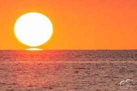 """YouTG.NET - La rara illusione ottica del """"Sole a omega"""": lo spettacolare  scatto del tramonto a Masua"""