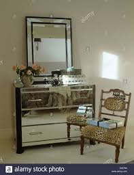 Modern Bedroom Chest Of Drawers Large Mirror Above Mirrored Chest Of Drawers In Modern Bedroom