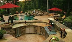 beige stone poolside outdoor kitchen