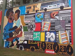 ... and assistant Lynn Edwards led a team of 37 teenagers in the design of  this mural. It was painted on the side of Orr Academy High School in 1997.