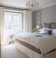 interior white blue bed sheet with brown pillow placed on the white rug combined with glass bedroom white bed set
