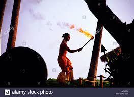 lighting tiki torches. Hawaiian Man Lighting Tiki Torches At Sunset Drums Of The Pacific Luau Hyatt Regency Maui Kaanapali Beach Resort Hawaii USA