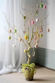room decoration ideas using waste material. just collect few waste materials or recycled and decorate your indoor tree with them. room decoration ideas using material d