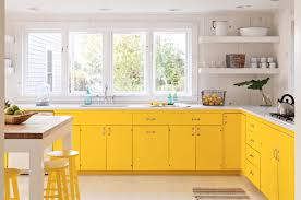 Kitchen Cabinets With Windows Yellow Kitchen Cabinet Design With Windows And Dining Table 2222