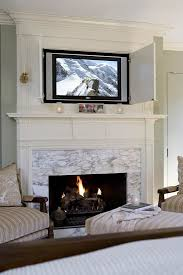 hide tv closed cabinet above your fireplace