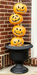 stacked pumpkin heads pumpkin topiary for front door decorations