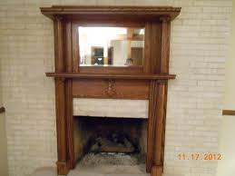 refinished red oak fireplace mantel