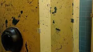 school bathroom door. Photos Of Harrisburg School Bathroom Show Graffiti, Falling Sign, Missing Tile, Door
