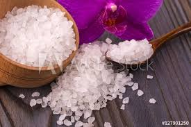 white bath salt in a wooden bowl
