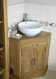 simple wooden vanity ikea with white ceramic bowl sink for cool small bathroom decor