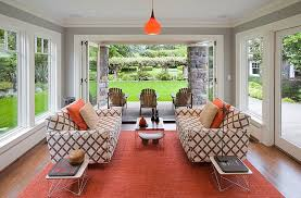 ... Twin Eames Wire Tables add to the style of the cool sunroom [Design:  Emerick