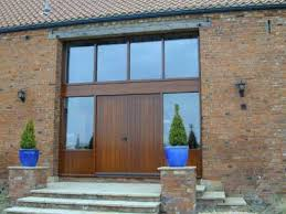 Purpose made entrance frame and 2.4m high doors in douglas fir,
