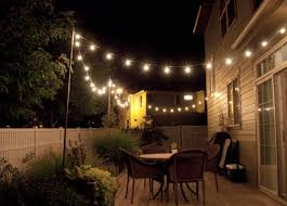 beautiful outdoor lighting. Simple Outdoor String Lighting With Wicker Dining Chairs For Family Party Beautiful A