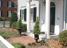 These planted urns frame the front door entrance.