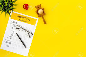 Mock Application Form Application Form For Adopt Child On Yellow Table Background Top
