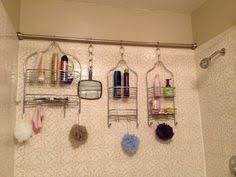Easy shower organization for a family of five. Shower Rod across the back  of the