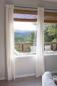 ikea ritva curtains over bamboo roman shades dark curtain rod love the natural outdoor feel of bamboo