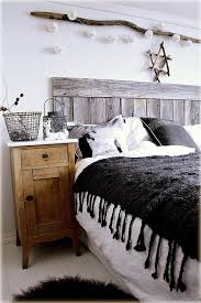 Weathered wood planks are a perfect materials for DIY rustic decor pieces,  like headboards.