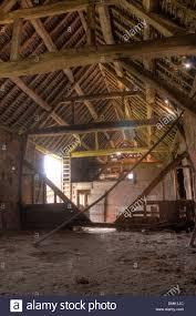 Timber-frame and brick hay barn interior, Warwickshire, England ...