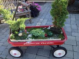 Cute red wagon fairy garden container! www.wolfsbloomsandberries.com