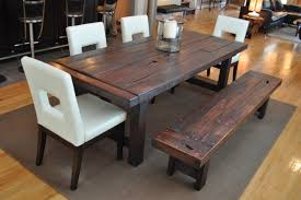 eclectic dining room ideas with grey rug and modern solid wood dining table using long wooden bench and white chairs