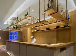 restaurant interior design ideas this restaurant s bar has hanging wooden shelving to match the live